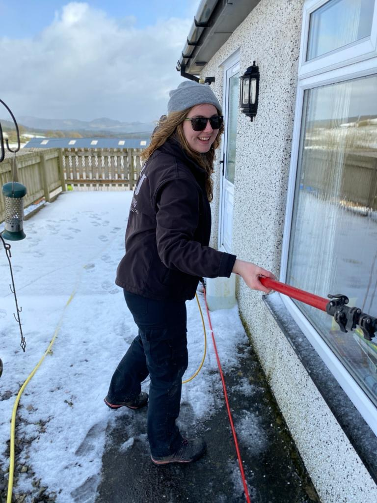 Anna Cleaning Windows in the snow