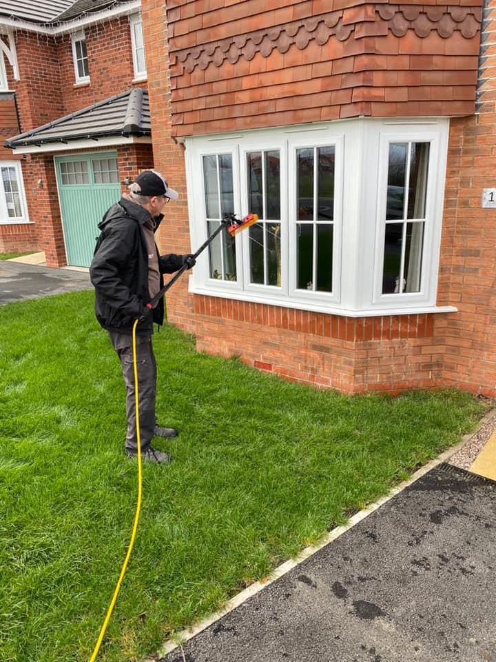 Adam cleaning domestic windows